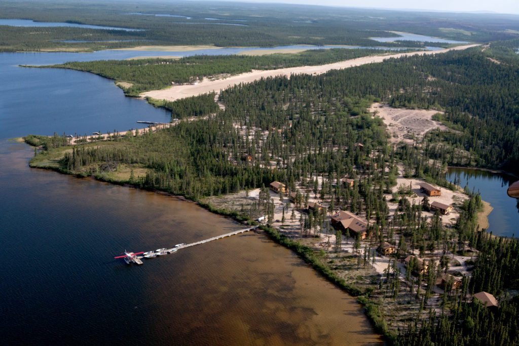 Aerial view of the North Seal River lodge and it's float plane and boat dock