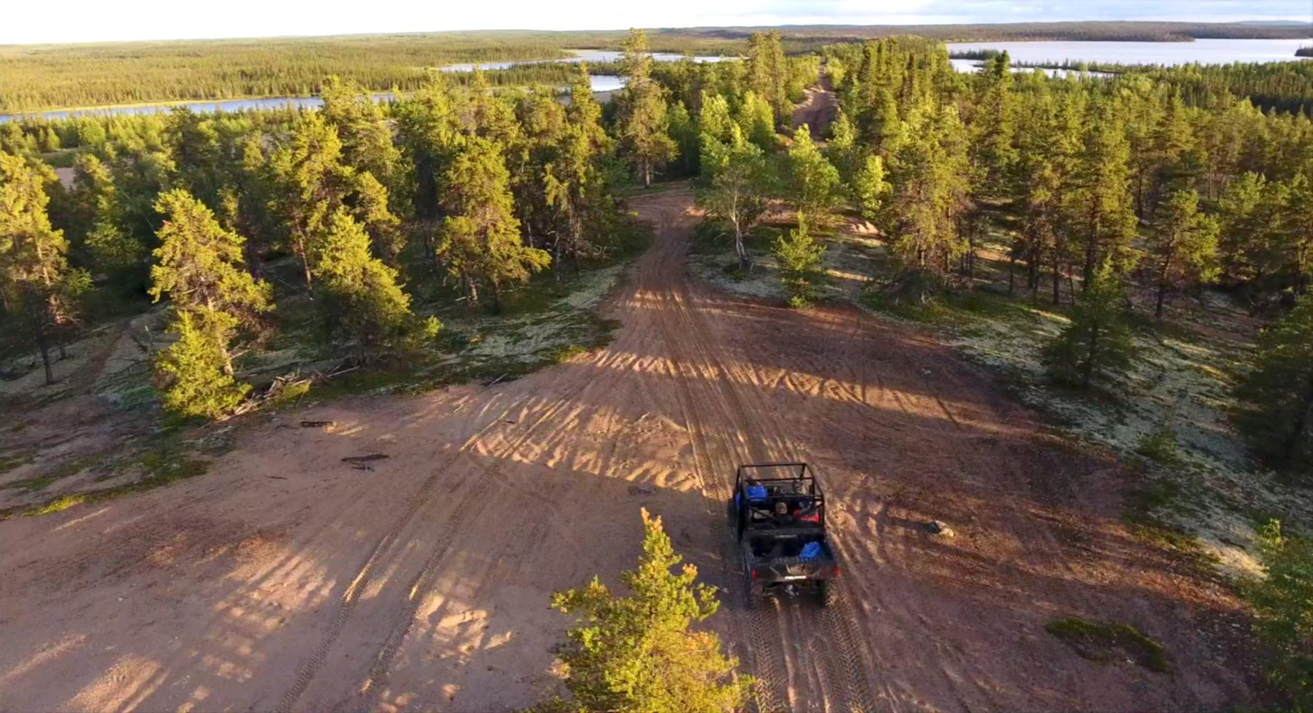 Aerial video of people riding in an ATV over the south esker